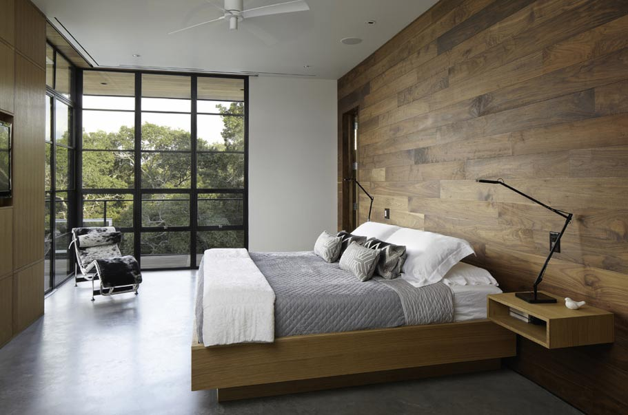 A Warm Bedroom That Mixes Wood, Light, And Simple, Contemporary Furnishings  For A Minimalist But Welcoming Feel. Striking Wood Wall And Built In  Storage ...